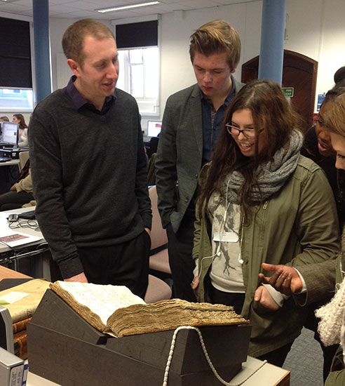 Matthew Neely, Bodleian archivist in charge of the Rycote website, shows original manuscripts to sixth formers