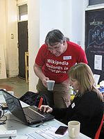 Doug Taylor helping with a participant at an event with the Manchester Girl Geeks